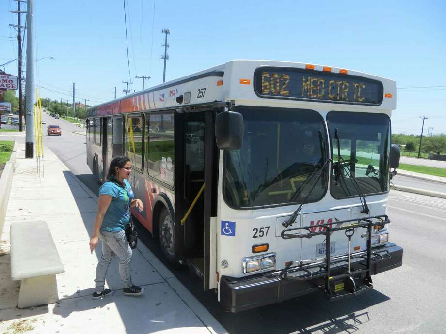 Rosa Rangel of San Antonio boards a VIA bus in Castle Hills, where she travels regularly by bus to drop off her children with relatives or pick them up. Photo: Zeke MacCormack /San Antonio Express-News