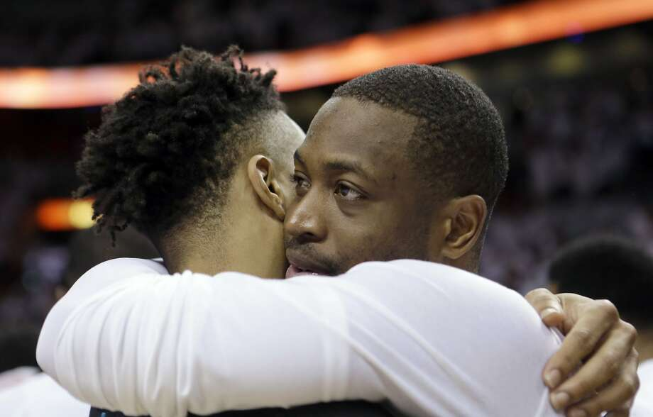 Heat guard Dwyane Wade (right) hugs Charlotte's Courtney Lee after the Heat won Game 7. Photo: Alan Diaz, Associated Press