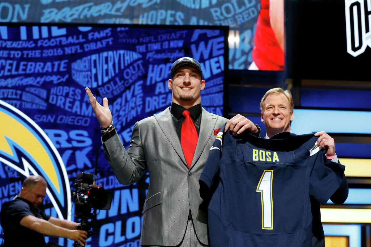 Ohio State's Joey Bosa poses for photos with NFL commissioner Roger Goodell after being selected by the San Diego Chargers as the third pick in the first round of the 2016 NFL football draft, Thursday, April 28, 2016, in Chicago. (AP Photo/Charles Rex Arbogast)