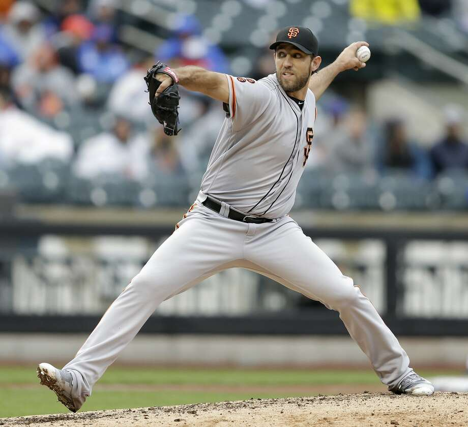 San Francisco Giants starting pitcher Madison Bumgarner throws during the sixth inning of the baseball game against the New York Mets at Citi Field, Sunday, May 1, 2016 in New York. The Giants defeated the Mets 6-1. (AP Photo/Seth Wenig) Photo: Seth Wenig, Associated Press