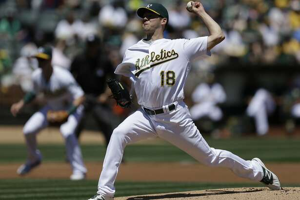 Oakland Athletics pitcher Rich Hill works against the Houston Astros in the first inning of a baseball game Sunday, May 1, 2016, in Oakland, Calif. (AP Photo/Ben Margot)