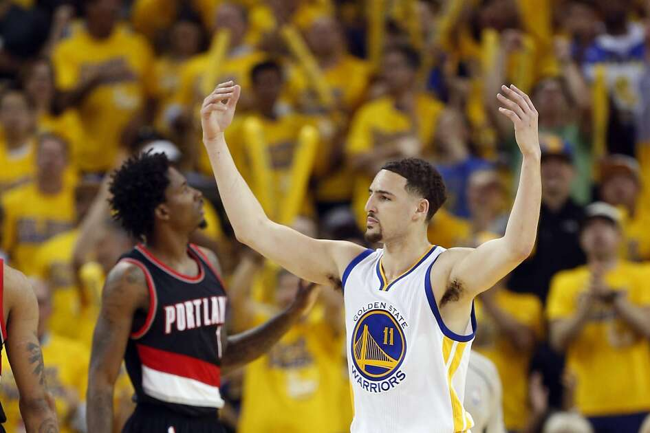 Golden State Warriors' Klay Thompson celebrates in 1st quarter against Portland Trail Blazers during Game 1 of NBA Playoffs' Western Conference Semifinals at Oracle Arena in Oakland, Calif., on Sunday, May 1, 2016.