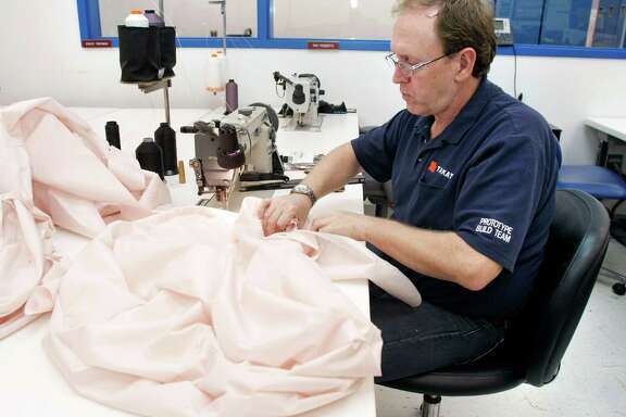 A Takata employee sews an air bag at Takata's crash-testing facility in Auburn Hills, Mich. Takata air bag inflaters in 28.8 million cars can propel metal shrapnel into drivers and passengers. Ten people in the U.S. have died from such explosions and more than 100 have been injured.