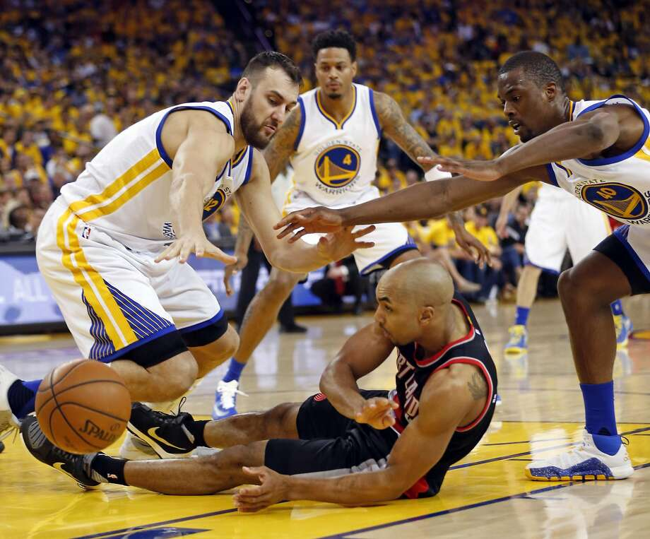 Golden State Warriors' Andrew Bogut and Harrison Barnes pressure Portland Trail Blazers' Gerald Henderson in 2nd quarter during Game 1 of NBA Playoffs' Western Conference Semifinals at Oracle Arena in Oakland, Calif., on Sunday, May 1, 2016. Photo: Scott Strazzante, The Chronicle