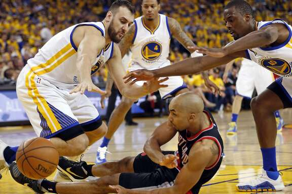Golden State Warriors' Andrew Bogut and Harrison Barnes pressure Portland Trail Blazers' Gerald Henderson in 2nd quarter during Game 1 of NBA Playoffs' Western Conference Semifinals at Oracle Arena in Oakland, Calif., on Sunday, May 1, 2016.