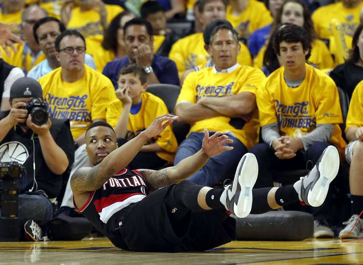 Portland Trail Blazers' Damian Lillard reacts to a non-call during Golden State Warriors' 118-106 win during Game 1 of NBA Playoffs' Western Conference Semifinals at Oracle Arena in Oakland, Calif., on Sunday, May 1, 2016.