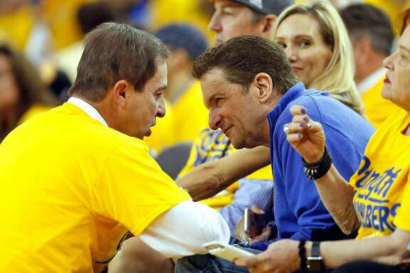Golden State Warriors' co-owners' Joe Lacob and Peter Guber confer during Warriors' 118-106 win over Portland Trail Blazers in Game 1 of NBA Playoffs' Western Conference Semifinals at Oracle Arena in Oakland, Calif., on Sunday, May 1, 2016.