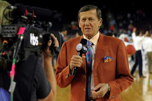 Broadcaster Craig Sager talks on camera before the NCAA Final Four tournament college basketball championship game between Villanova and North Carolina, Monday, April 4, 2016, in Houston. (AP Photo/David J. Phillip)