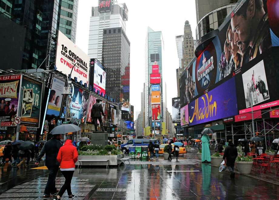 Some of the many digital billboards displaying advertisements rise above a pedestrian plaza in Times Square,  Sunday, May 1, 2016, in New York.  A U.S. senator is calling for a federal investigation into an outdoor advertising company?s latest effort to target billboard ads to specific consumers. New York Sen. Charles Schumer has dubbed Clear Channel Outdoor Americas? so-called RADAR program ?spying billboards,? warning the service may violate privacy rights by tracking people?s cell phone data and using them to sell ad space. ?A person?s cellphone should not become a James Bond-like personal tracking device for a corporation to gather information about consumers without their consent,? Schumer, a Democrat, said in a statement prior to a news conference in Times Square. (AP Photo/Kathy Willens) Photo: Kathy Willens, STF / Copyright 2016 The Associated Press. All rights reserved. This material may not be published, broadcast, rewritten or redistribu
