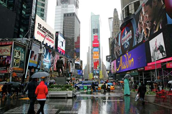Some of the many digital billboards displaying advertisements rise above a pedestrian plaza in Times Square,  Sunday, May 1, 2016, in New York.  A U.S. senator is calling for a federal investigation into an outdoor advertising company?s latest effort to target billboard ads to specific consumers. New York Sen. Charles Schumer has dubbed Clear Channel Outdoor Americas? so-called RADAR program ?spying billboards,? warning the service may violate privacy rights by tracking people?s cell phone data and using them to sell ad space. ?A person?s cellphone should not become a James Bond-like personal tracking device for a corporation to gather information about consumers without their consent,? Schumer, a Democrat, said in a statement prior to a news conference in Times Square. (AP Photo/Kathy Willens)
