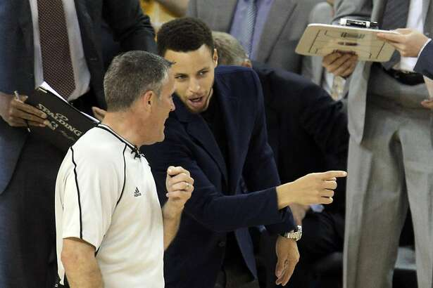 Stephen Curry (30) chats with a referee during a timeout in the first half as the Golden State Warriors played the Portland Trail Blazers at Oracle Arena in Oakland , Calif., on Monday, April 25, 2016., Calif., on Sunday, May 1, 2016.