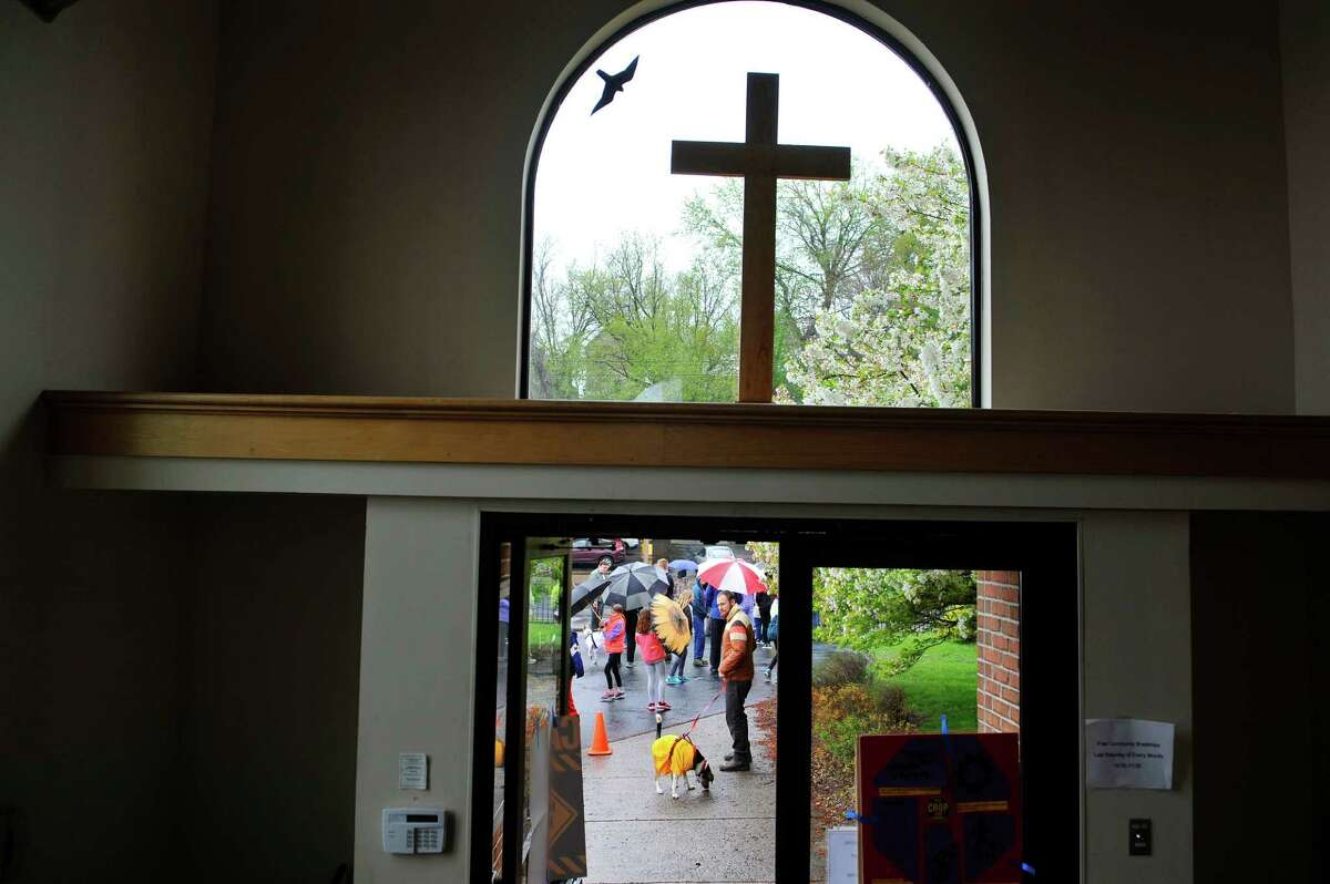 Participants in the 36th Annual Crop Walk make their out of the Emmanuel Friedens Church to begin their walk on Sunday, May 1, 2016, in Schenectady, N.Y. Those taking part in the walk found sponsors who donate money for the person walking. A portion of the funds raised go to overseas relief and refugee resettlement and the remaining funds are used locally for for food pantries and meal programs. (Paul Buckowski / Times Union)