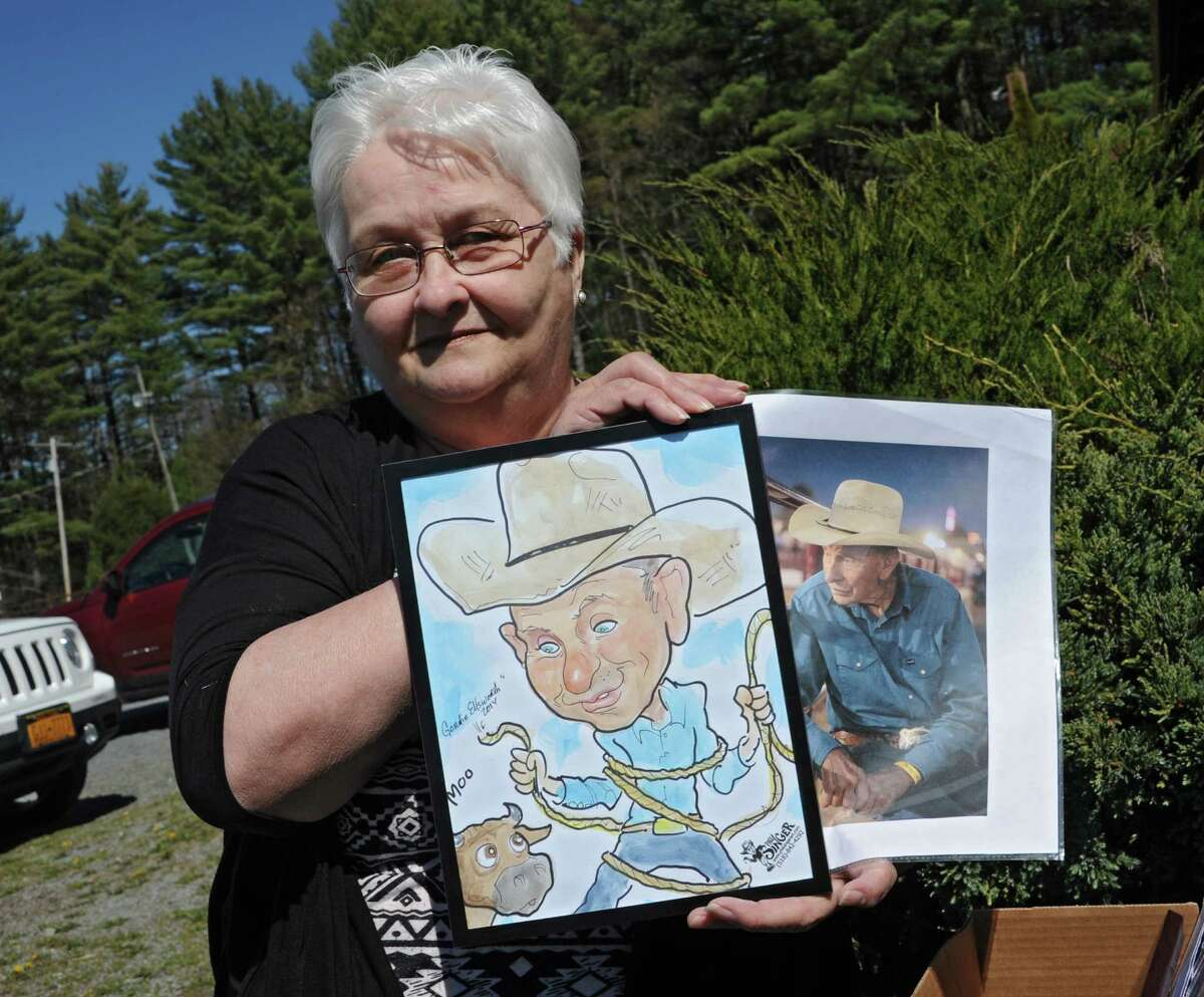 Pam Morin, historian for the Warren County town of Lake Luzerne, holds a caricature and photo of team roper Gordie Ellsworth at the Painted Pony on Wednesday, April 27, 2016 in Lake Luzerne, N.Y. (Lori Van Buren / Times Union)
