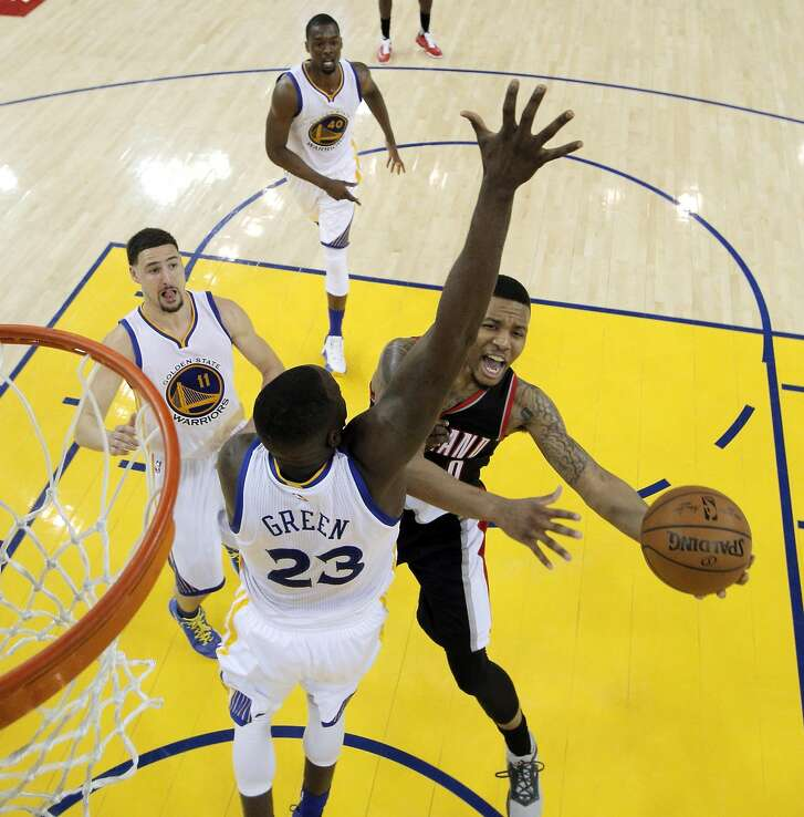 Damian Lillard (0) drives to the basket in the first half as the Golden State Warriors played the Portland Trail Blazers at Oracle Arena in Oakland , Calif., on Monday, April 25, 2016., Calif., on Sunday, May 1, 2016.