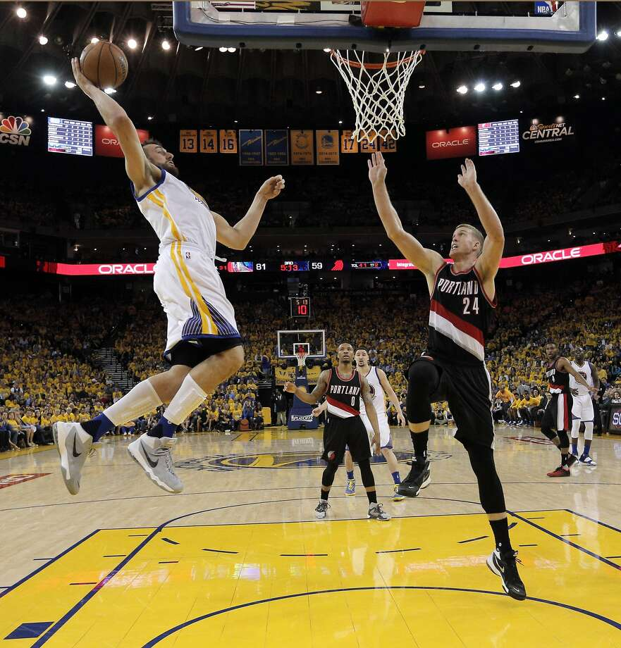 Andrew Bogut (12) goes in for a dunk in the second half as the Golden State Warriors played the Portland Trail Blazers at Oracle Arena in Oakland , Calif., on Monday, April 25, 2016., Calif., on Thursday, February 2, 2012. Photo: Carlos Avila Gonzalez, The Chronicle