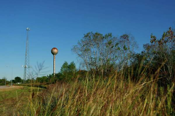 Two structures on adjoining property along Willowbend Boulevard tower above 332 acre plot of land in southwest Houston where the University of Texas plans to build a research facility, Thursday, Nov. 19, 2015.