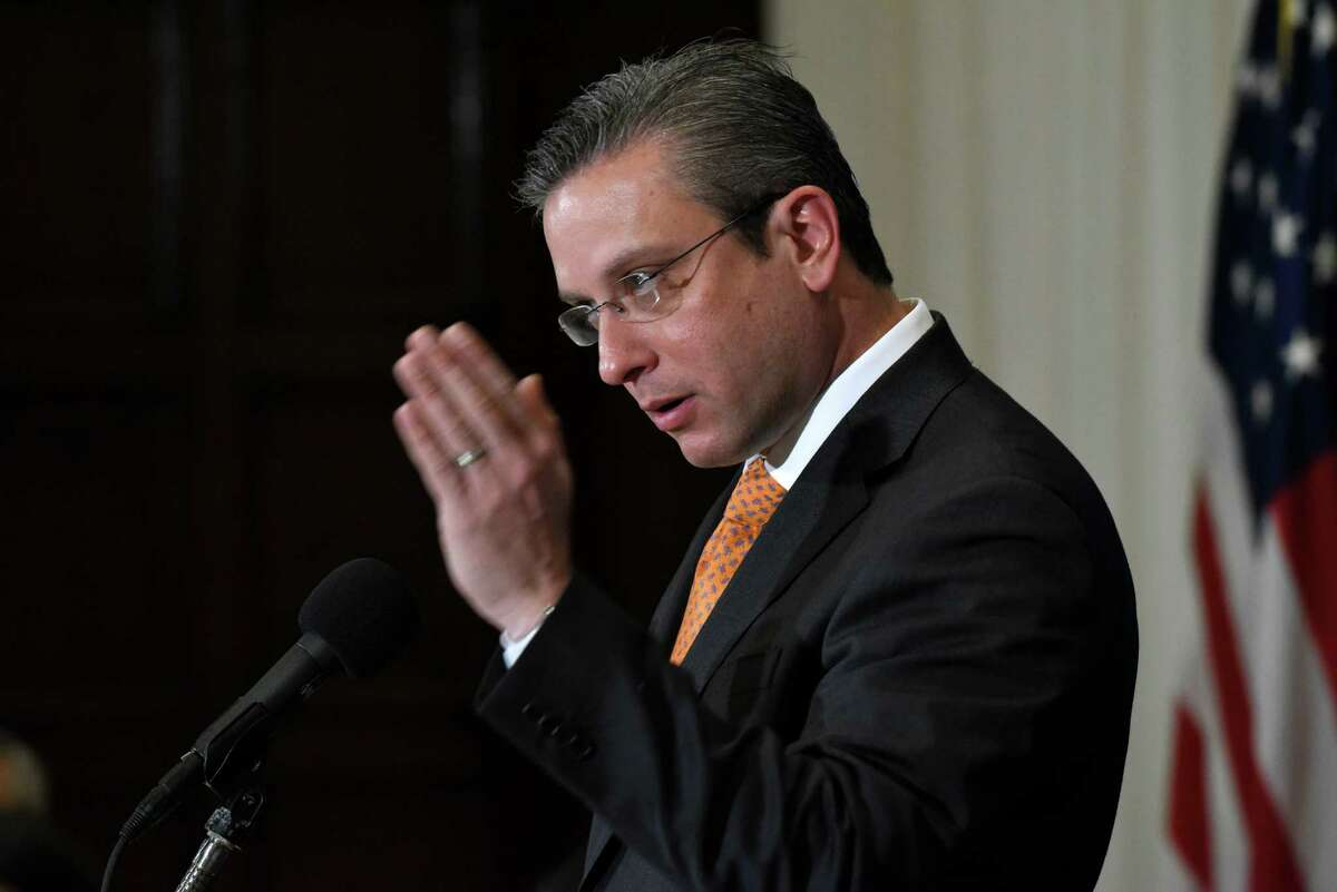 FILE - In this Dec. 16, 2015, file photo, Puerto Rico Gov. Alejandro Javier Garcia Padilla speaks at a luncheon at the National Press Club in Washington. Garcia said on Sunday, May 1, 2016, that negotiators for the U.S. territoryÂ?'s government have failed to reach a last-minute deal to avoid a third default and that he has issued an executive order to withhold payment. (AP Photo/Sait Serkan Gurbuz, File)
