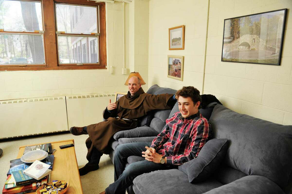 Siena College, friar, Father Larry Anderson, left, and freshman student Vincent Mills talk in Father Anderson's room, which is in the residence hall with students, on Wednesday, April 27, 2016, in Loudonville, N.Y. (Paul Buckowski / Times Union)