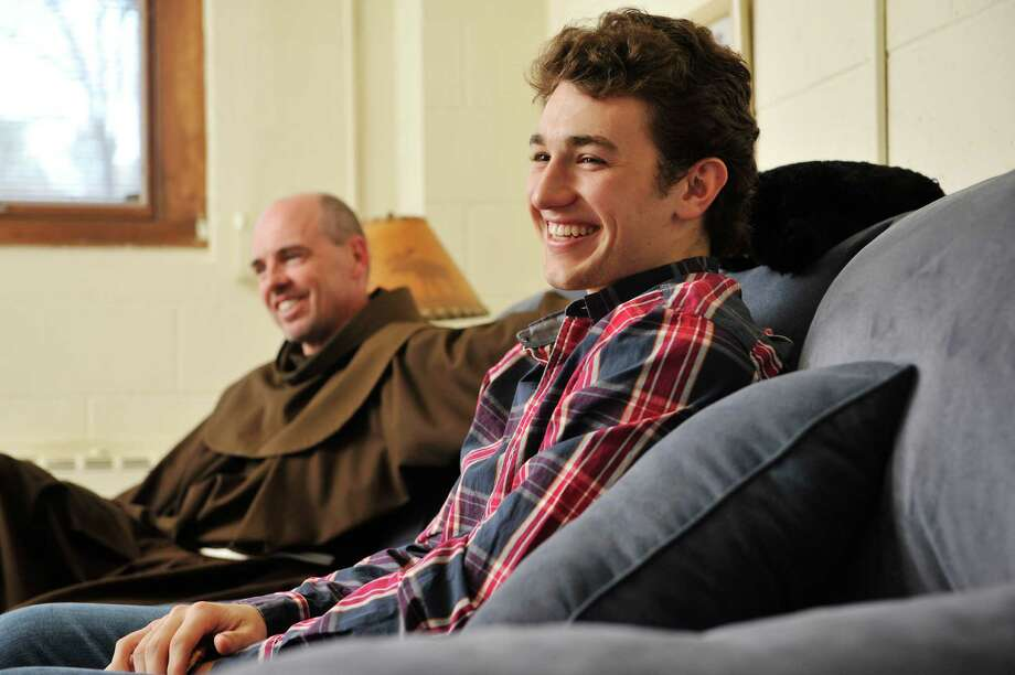 Siena College, friar, Father Larry Anderson, left, and freshman student Vincent Mills talk in Father Anderson's room, which is in the residence hall with students, on Wednesday, April 27, 2016, in Loudonville, N.Y.  (Paul Buckowski / Times Union) Photo: PAUL BUCKOWSKI / 10036382A