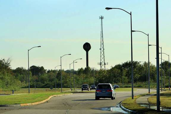 "Cars drive along Willowbend Boulevard, which cuts through the center of a 300-acre swath of land where UT plans to build an ""intellectual hub,"" according to Chancellor William McRaven."