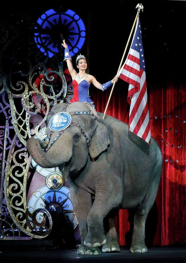 An Asian elephant performs during the national anthem for the final time in the Ringling Bros. and Barnum & Bailey Circus Sunday, May 1, 2016, in Providence, R.I. the The circus closes its own chapter on a controversial practice that has entertained audiences since circuses began in America two centuries ago. The animals will live at the Ringling Bros. 200-acre Center for Elephant Conservation in Florida. (AP Photo/Bill Sikes) Photo: Bill Sikes, STF / Copyright 2016 The Associated Press. All rights reserved. This material may not be published, broadcast, rewritten or redistribu