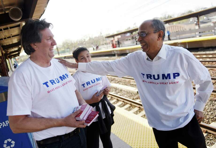 Donald Trump supporter Joe Visconti, left, a former gubernatorial candidate, chats with his neice Isabelle Blackburn, 11, of Farmington, and volunteer Ajay Shah, of Danbury, while distributing Trump handouts at the Greenwich Metro-North station Thursday. Photo: Tyler Sizemore / Hearst Connecticut Media / Greenwich Time