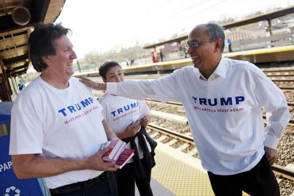 Donald Trump supporter Joe Visconti, left, a former gubernatorial candidate, chats with his neice Isabelle Blackburn, 11, of Farmington, and volunteer Ajay Shah, of Danbury, while distributing Trump handouts at the Greenwich Metro-North station Thursday.