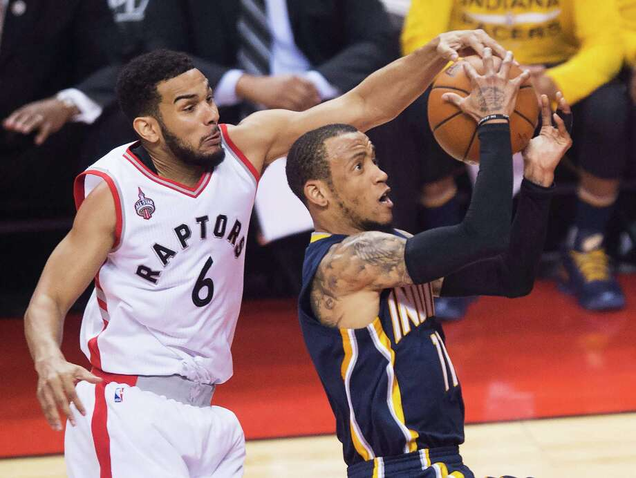 The Raptors' Cory Joseph swoops in from behind to stop a drive by the Pacers' Monta Ellis. Photo: Nathan Denette, SUB / The Canadian Press