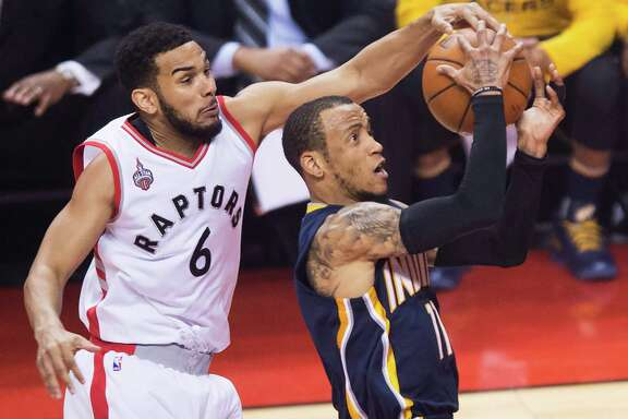 The Raptors' Cory Joseph swoops in from behind to stop a drive by the Pacers' Monta Ellis.