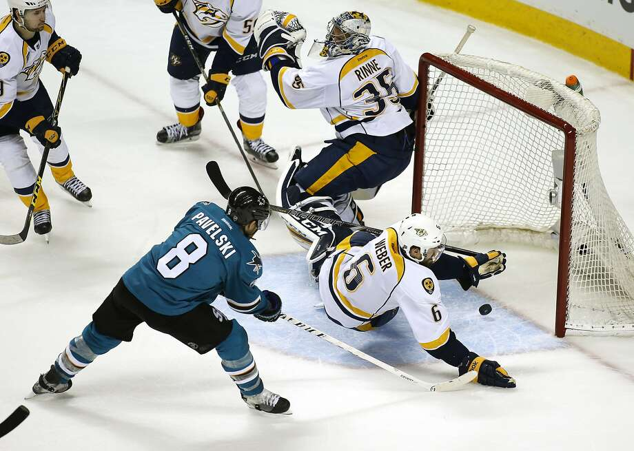 Joe Pavelski slips a rebound past defenseman Shea Weber and goalie Pekka Rinne to give the Sharks a 2-1 lead in the third. Photo: Tony Avelar, Associated Press