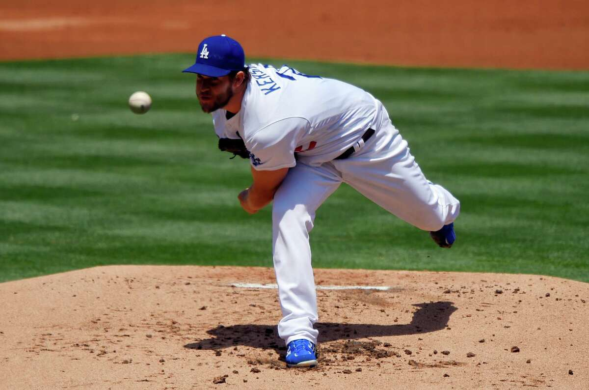 Los Angeles Dodgers starting pitcher Clayton Kershaw throws to the plate during the second inning of a baseball game against the San Diego Padres, Sunday, May 1, 2016, in Los Angeles. (AP Photo/Mark J. Terrill) ORG XMIT: LAD102