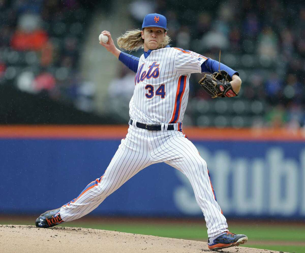 New York Mets starting pitcher Noah Syndergaard throws during the first inning of the baseball game against the San Francisco Giants at Citi Field, Sunday, May 1, 2016 in New York. (AP Photo/Seth Wenig) ORG XMIT: NYSW103