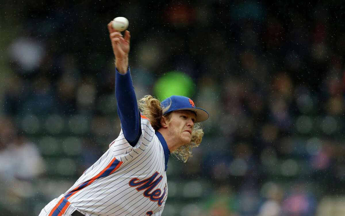 New York Mets starting pitcher Noah Syndergaard throws in a light rain during the first inning of the baseball game against the San Francisco Giants at Citi Field, Sunday, May 1, 2016 in New York. (AP Photo/Seth Wenig) ORG XMIT: NYSW101