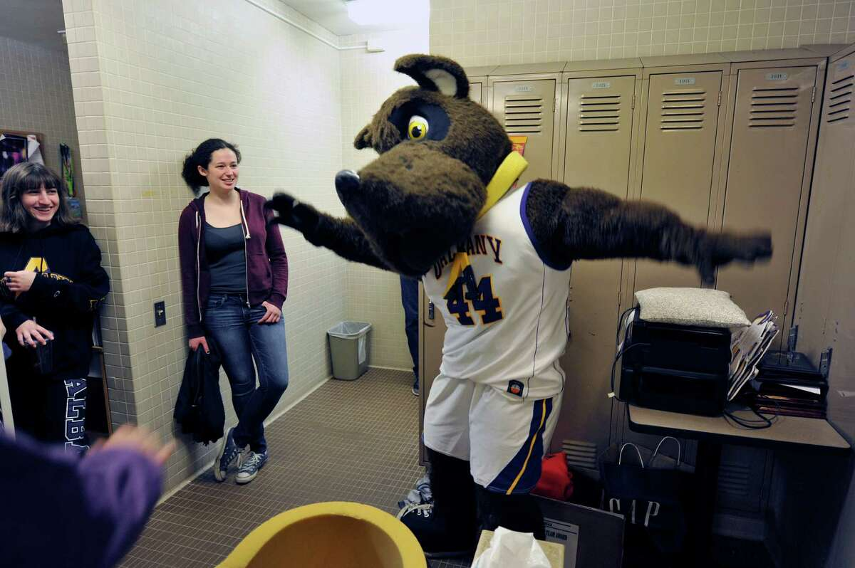 University at Albany freshman Brenda Mandel, left, from Manhattan, sophomore MaryKate Montemagno, second from left, from Sayville, watch as freshman Carolyn Solimine from Mamaroneck performs a dance move while wearing the Damien the Dane mascot outfit on Sunday, May 1, 2016, in Albany, N.Y. Montemagno and Noonan showed up for tryouts to be the mascot for next year. Mandel, a friend of Solimine came for moral support. (Paul Buckowski / Times Union)