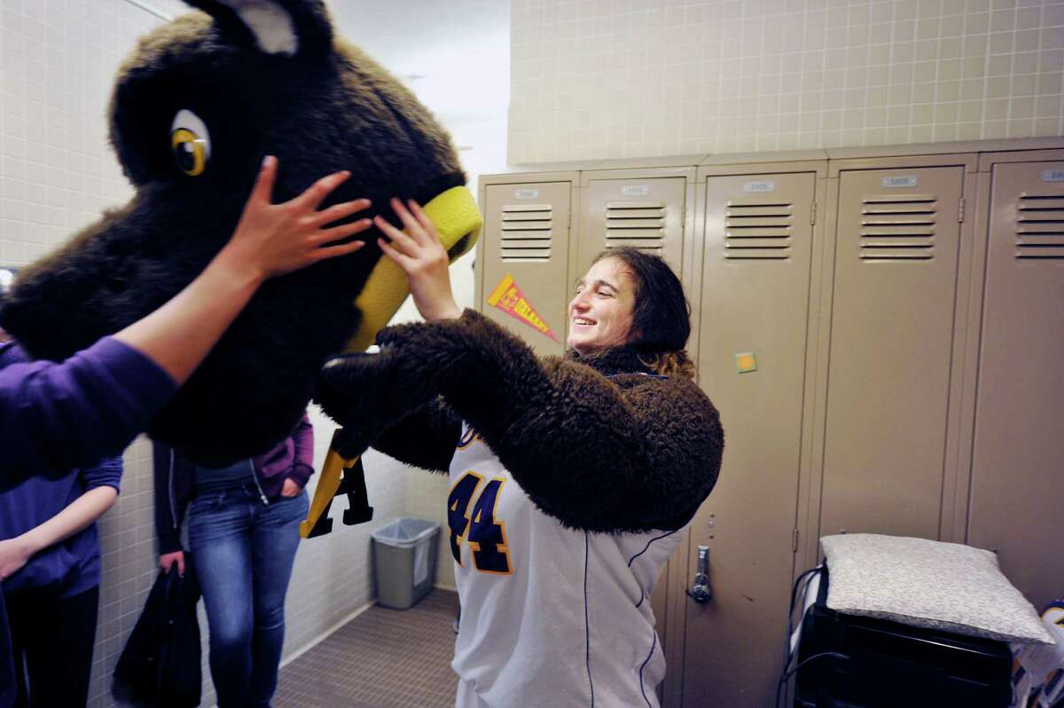 University at Albany freshman Carolyn Solimine from Mamaroneck tries on the Damien the Dane mascot outfit on Sunday, May 1, 2016, in Albany, N.Y. Solimine and a fellow student, sophomore MaryKate Montemagno showed up for tryouts to be the mascot. (Paul Buckowski / Times Union)