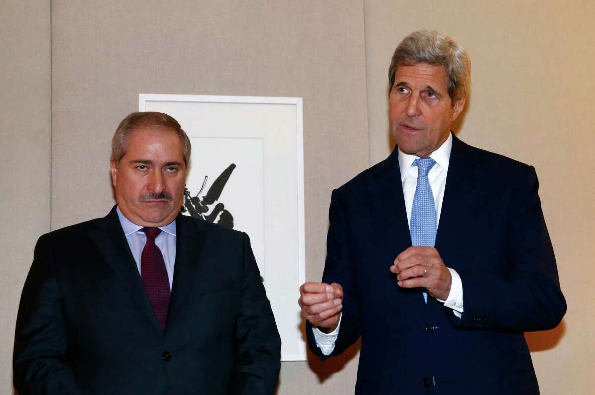 U.S. Secretary of State John Kerry, right, talks to the media next to Jordanian Foreign Minister Nasser Judeh, left, during a bilateral meeting on Syria in Geneva, Switzerland, Sunday, May 1, 2016. Kerry has appealed once more to his Russian counterpart for assistance in containing and reducing the violence, particularly around the Syrian city of Aleppo. (Denis Balibouse/Pool via AP) ORG XMIT: LON144