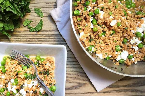 Baked farro with spring peas, mint and feta