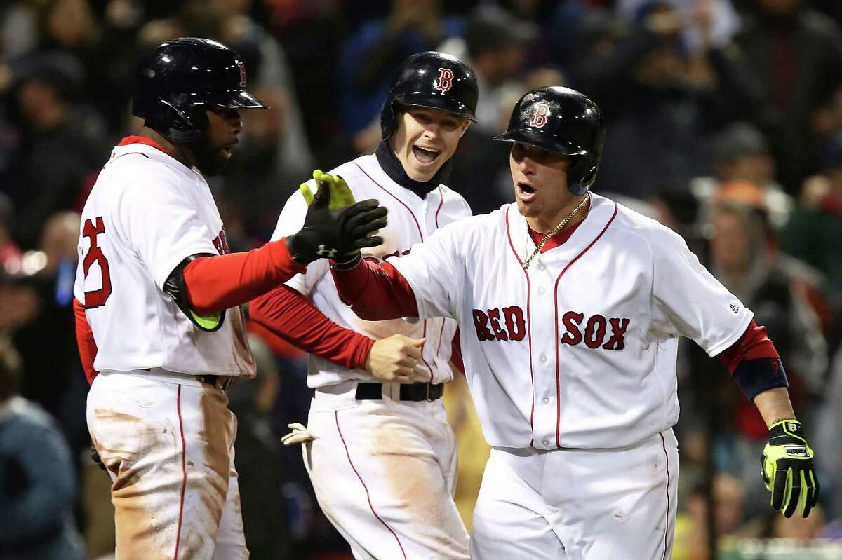 BOSTON, MA - MAY 01: Christian Vasquez #7 of the Boston Red Sox returns to the dugout after hitting a two-run home run in the seventh inning during the game against the New York Yankees at Fenway Park on May 1, 2016 in Boston, Massachusetts. (Photo by Adam Glanzman/Getty Images) ORG XMIT: 629953813