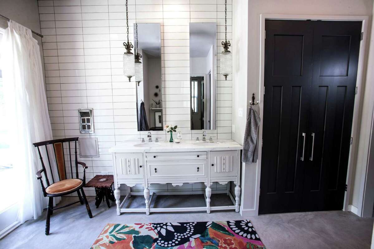 ON TREND: Turning old furniture into new fixtures is one of our favorite trends of the year. This master bath lavatory is an antique buffet painted white and topped with Calacatta Gold marble.See the rest of the home on houstonchronicle.com: Houston designer creates her dream home in country