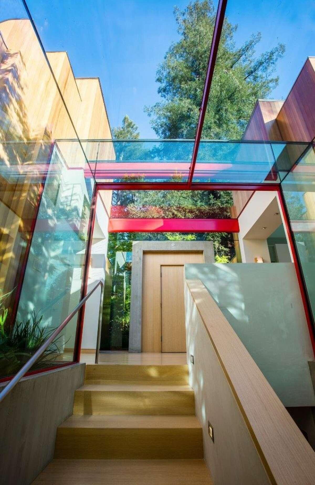 Glass entry. Photos: MLS/Estately