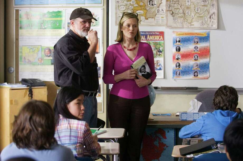 """Norwalk_051008_ Chris Campbell, Director and Co-Exective Producer,  talks to Mary Ann Wasil Nilan, who plays the part of teacher Jane Hoff, as the crew films a scene at Roton Middle School for the """"Frederick Douglass"""" episode from the  upcoming CT Public Television project  """"Young American Heroes"""". Kathleen O'Rourke/Staff photo Staff Photo Kathleen O'Rourke Photo: Kathleen O'Rourke / ST / 00006796A"""
