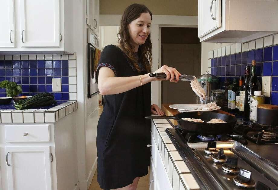 Zuni Cafe chef Rebecca Boice fries bone-in chicken at her Oakland home. Photo: Liz Hafalia, The Chronicle