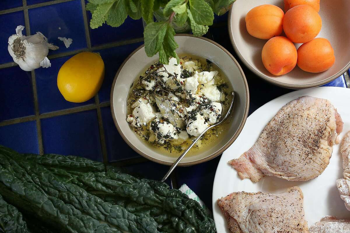 Zuni Cafe chef Rebecca Boice has some ingredients on the counter as she prepares to make cast iron skillet chicken with meyer lemon and mint, and kale salad with marinated feta and sesame seeds at home in Berkeley, California on friday, april 29, 2016.