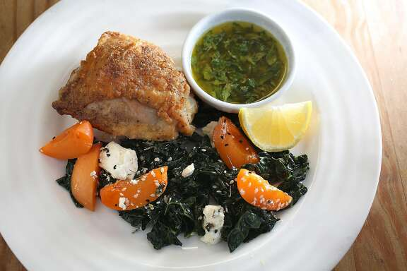 Zuni Cafe chef Rebecca Boice prepares cast iron skillet chicken with meyer lemon and mint, and kale salad with marinated feta. apricots,  and sesame seeds at home in Berkeley, California on friday, april 29, 2016.