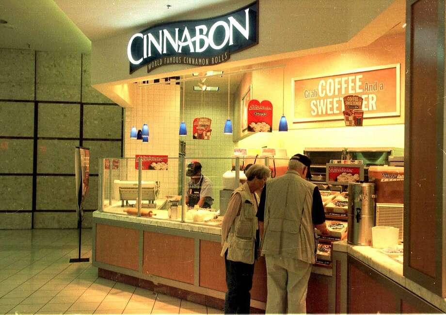 Cinnabon: The chain's newest creation, the Cinnamon Cookie BonBite, is a cinnamon roll inside a chocolate chip cookie. Photo: PHILIP MCCOLLUM, BLOOMBERG NEWS