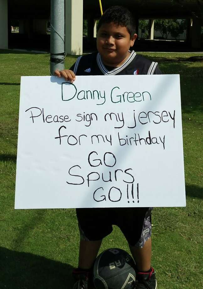 """Josh Xon, 13, asked his """"idol, Danny Green, to sign his jersey using this sign on April 30, 2016. Photo: Provided By AnnMarie Mikelski"""