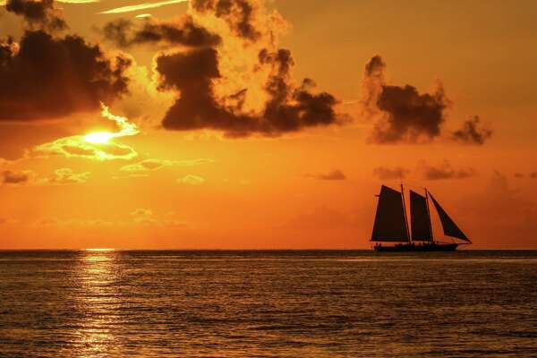 Charter one of Key West's historic schooners for a sunset cruise for breathtaking views of the setting sun.
