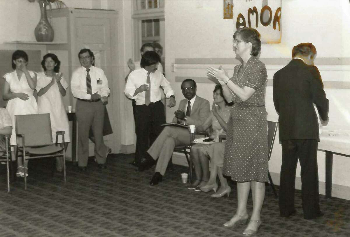 Sister Christine Stephens (top photo) leads an evaluation meeting in TMO's early days in 1979 to discuss the outcome of a mayoral candidates'