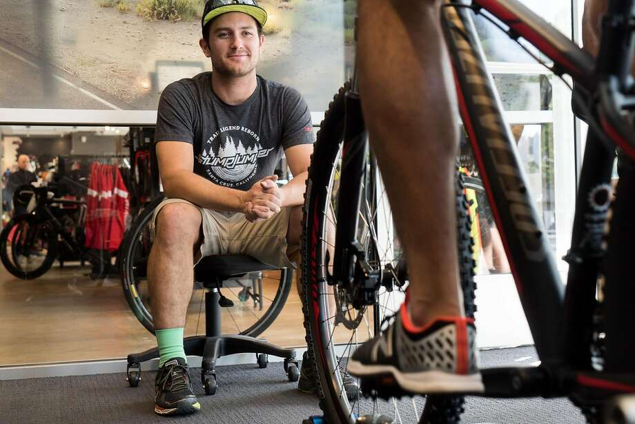 Torr Hage helps to fit a customer at Cognition Cyclery in Mountain View. Photo: James Tensuan, Special To The Chronicle