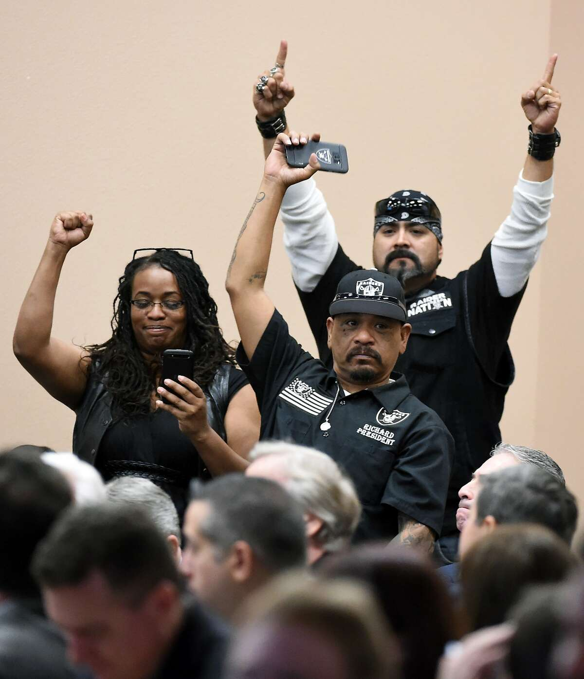 LAS VEGAS, NV - APRIL 28: Oakland Raiders fans react after being acknowledged during a Southern Nevada Tourism Infrastructure Committee meeting at UNLV attended by Raiders owner Mark Davis on April 28, 2016 in Las Vegas, Nevada. Davis told the committee he is willing to spend USD 500,000 as part of a deal to move the team to Las Vegas if a proposed USD 1.3 billion, 65,000-seat domed stadium is built by casino magnate Sheldon Adelson's Las Vegas Sands Corp. and real estate agency Majestic Realty, possibly on a vacant 42-acre lot a few blocks east of the Las Vegas Strip recently purchased by UNLV. (Photo by Ethan Miller/Getty Images)